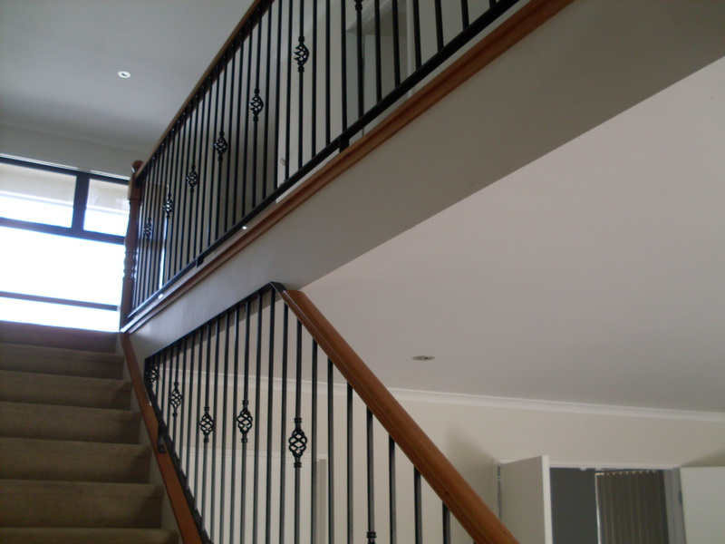 Wrought iron with rimu handrail